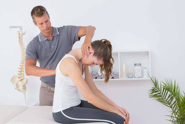 bigstock Doctor doing neck adjustment i 101649617